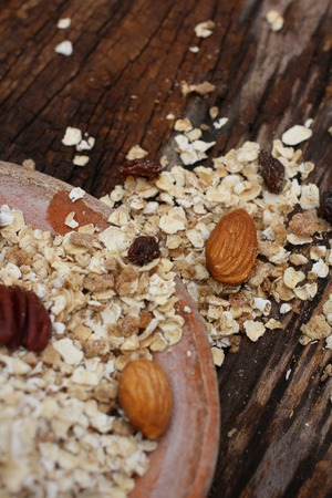 Mix of tasty nuts and oat flakes photo