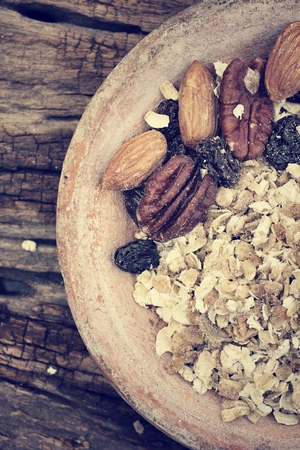 Mix of tasty nuts and oat flakes - vintage style photo