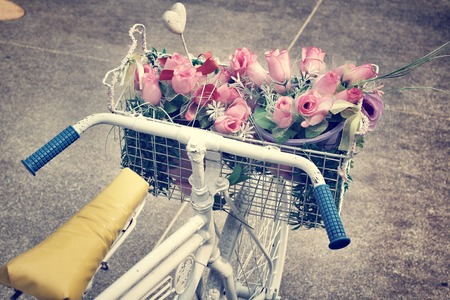 Vintage rose of artificial flowers and bicycle photo
