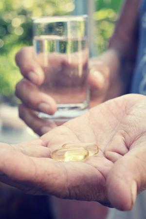 cod liver: cod liver oil capsules Stock Photo