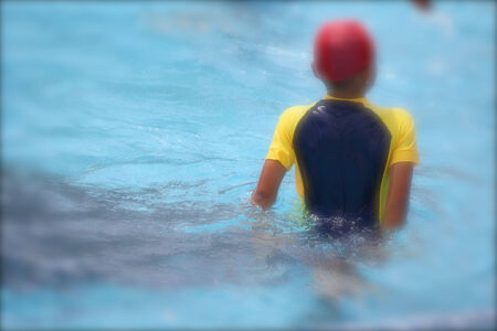 Blurred of children playing in the pool photo