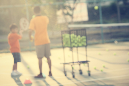 blurred of kid playing tennis