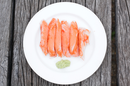 crabmeat: crab sticks  on wooden table
