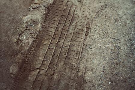 muddy tracks: Wheel tracks on the soil.
