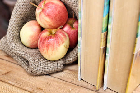 Apples with book photo