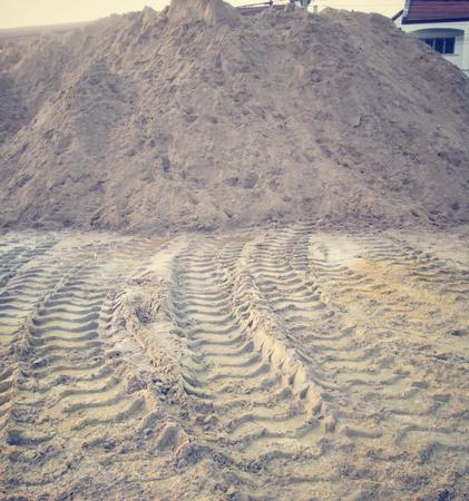 Wheel tracks on the soil. photo