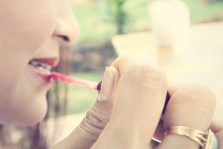 gloss: Woman with lip gloss