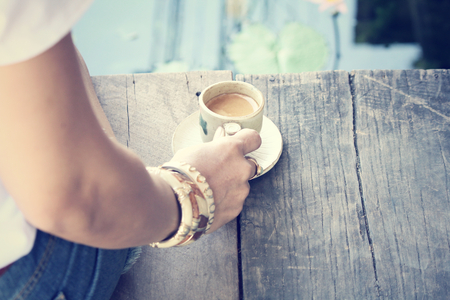 girl drinking: woman drinking coffee