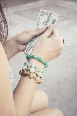 Woman with dollars photo