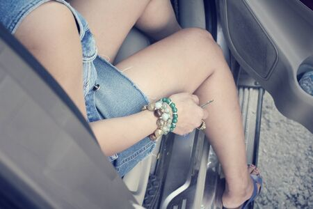 legs open: Woman sitting a car Stock Photo