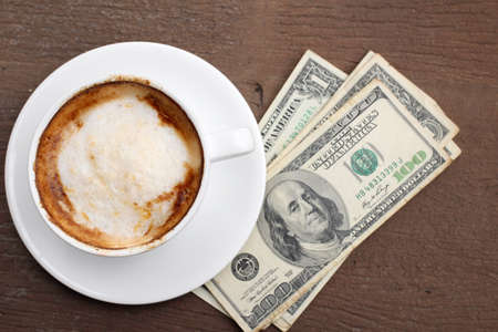 Hot coffee with dollars photo