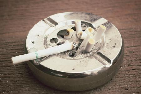 ashtray: Cigarette with ashtray