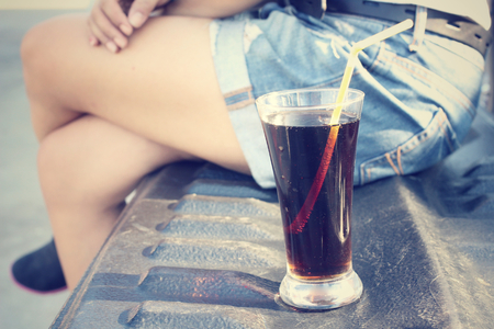 soda water: Woman drinking a cola Stock Photo