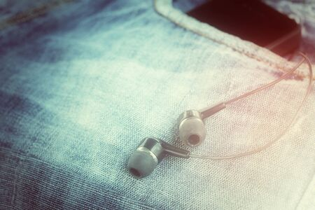 earphone: Earphone and smartphone with jeans