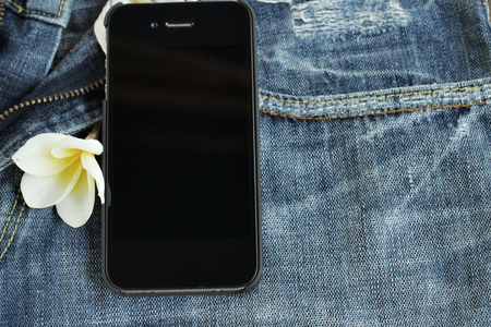 Smart phone with jeans photo