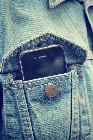 jeans pocket: Smart phone in jeans pocket Stock Photo