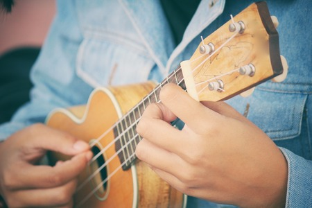 acoustic ukulele: woman playing ukulele Stock Photo