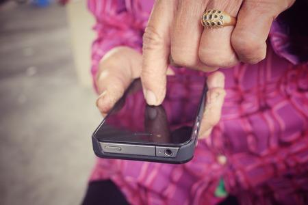 Senior using smart phone photo