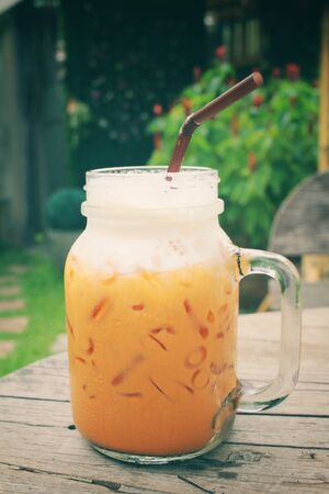 oolong tea: Ice oolong tea and milk on a jar Stock Photo