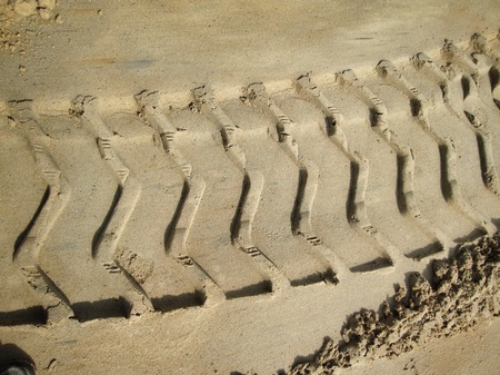 Wheel tracks on the soil. photo