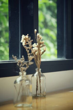 dried flower arrangement: Dried flowers in a vase Stock Photo