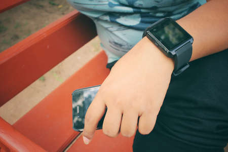 call of nature: Woman hands with smartwatch