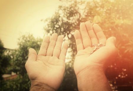 beautiful jesus: Senior man hands praying with cross Stock Photo