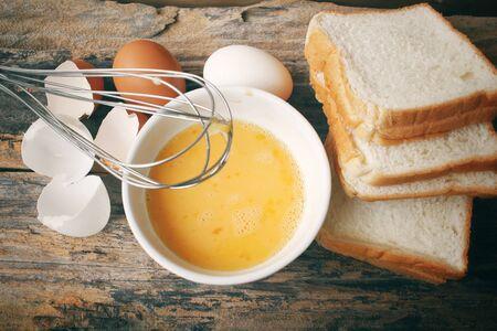 egg whisk: Bread egg with whisk