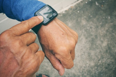 call of nature: Senior man with smartwatch