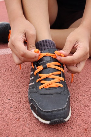shoelaces: Woman hands tying shoelaces