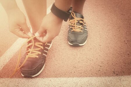 shoelaces: Woman hands tying shoelaces with smartwatch