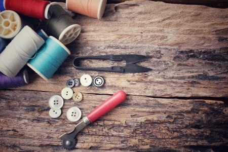 sewing buttons: Bobbins colorful threads ,sewing buttons and scissors