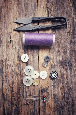 sewing buttons: Bobbins threads ,sewing buttons and scissors