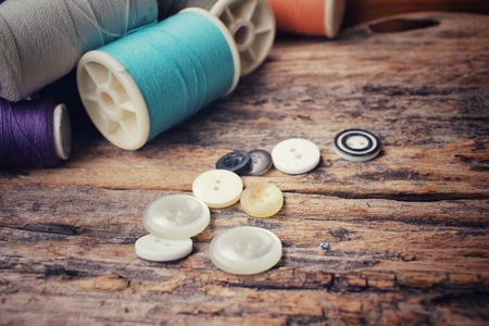 sewing buttons: Bobbins colorful threads with sewing buttons Stock Photo