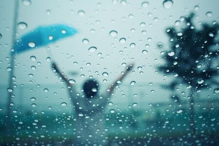 car background: Blurred of water drop with umbrella