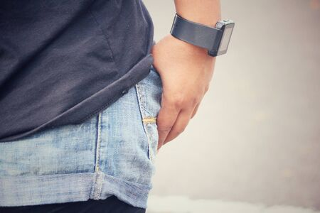 hand in pocket: Smartwatch on hand with jeans pocket