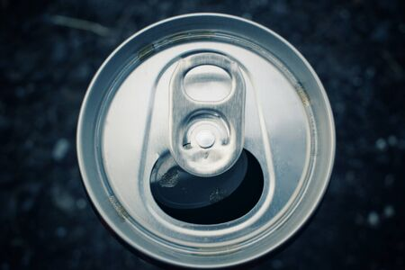 aluminum can: Aluminum can with hand Stock Photo