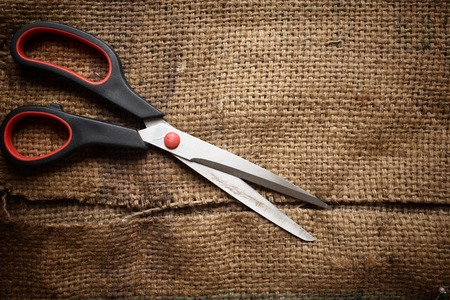 sackcloth: Scissors with sackcloth Stock Photo