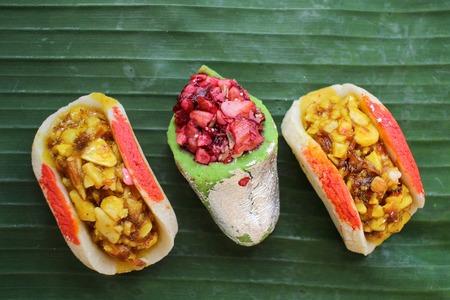 pakistani food: Indian sweets on banana leaf Stock Photo