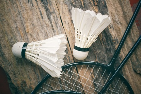 Shuttlecocks with badminton racket.
