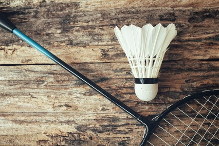 badminton: Shuttlecocks with badminton racket.