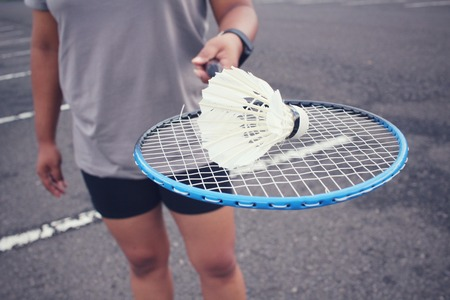 racket: Young female player badminton Stock Photo