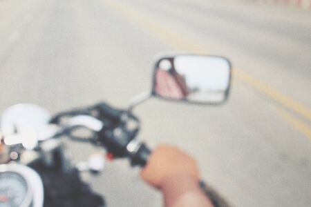 blurr: Driver riding motorcycle on the road