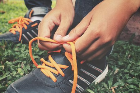 shoelaces: Hands tying shoelaces