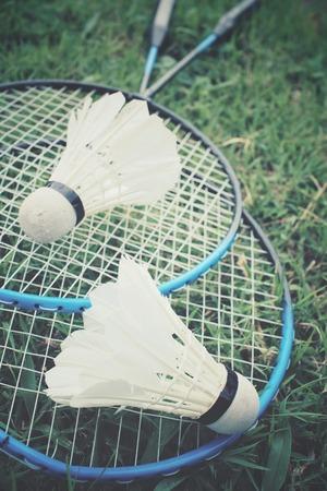 badminton racket: Shuttlecocks with badminton racket on green grass Stock Photo