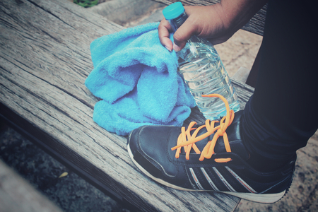 water shoes: Sport shoes with water drink and towel Stock Photo