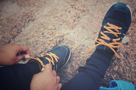 shoelaces: Woman hands tying shoelaces and towel Stock Photo