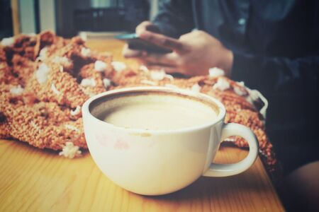 Woman drink coffee with smartphone and scart