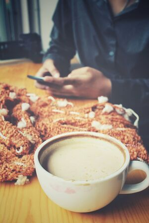 scart: Woman drink coffee with smartphone and scart