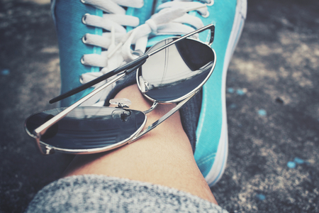 dirty feet: Sneakers with sun glasses